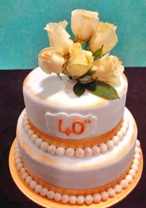 White roses on a white fondant cake