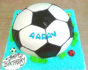 Buttercream and ganache blobbing on a football cake