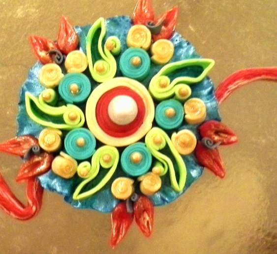 highlighted the Rakhi with a touch of gold ediple paint and edible sugar glitter