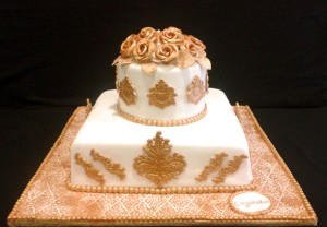 Gold and white fondant cake