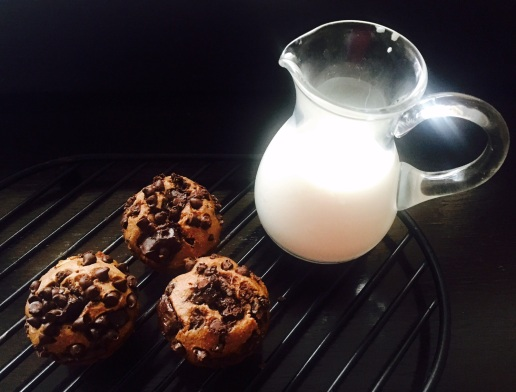 Soya flour infused chocolate chip muffins with a jug of cold milk